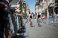 Teammates Fumi Beppu (JAP/Trek Factory Racing) &amp; Danny Van Poppel (NLD/Trek Factory Racing) riding their way back to the teambus after sign-in in the streets of Leuven<br /> <br /> 55th Brabantse Pijl 2015