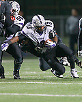 Ron Dogan gets brought down in the backfield against Bowie Friday at Burger Stadium.  (LOURDES M SHOAF for Round Rock Leader.)