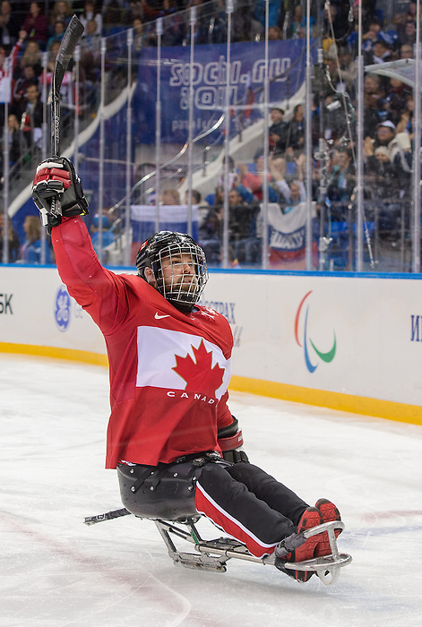 Sochi, RUSSIA - Mar 15 2014 - Billy Bridges celebrates his goal as Canada takes on Norway in the Bronze Medal Sledge Hockey game  at the 2014 Paralympic Winter Games in Sochi, Russia.  (Photo: Matthew Murnaghan/Canadian Paralympic Committee)