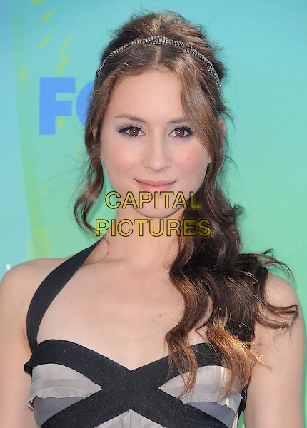 Troian Bellisario.2011 Teen Choice Awards - Arrivals held at Gibson Amphitheatre, Universal City, California, USA..August 7th, 2011.headshot portrait hairband beige black .CAP/RKE/DVS.©DVS/RockinExposures/Capital Pictures.