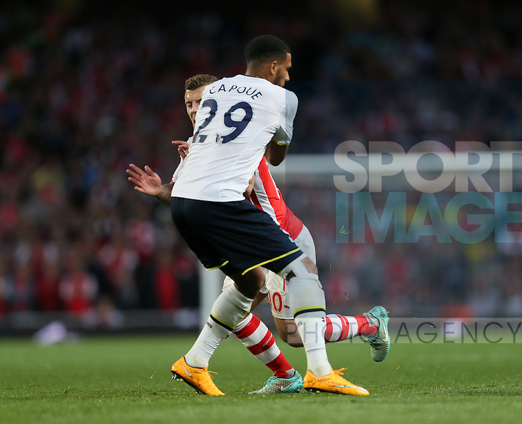 Arsenal's Jack Wilshere tussles with Tottenham's Etienne Capoue<br /> <br /> - Barclays Premier League - Arsenal vs Tottenham Hotspur - Emirates Stadium - England - 27th September 2014 - Picture David Klein/Sportimage