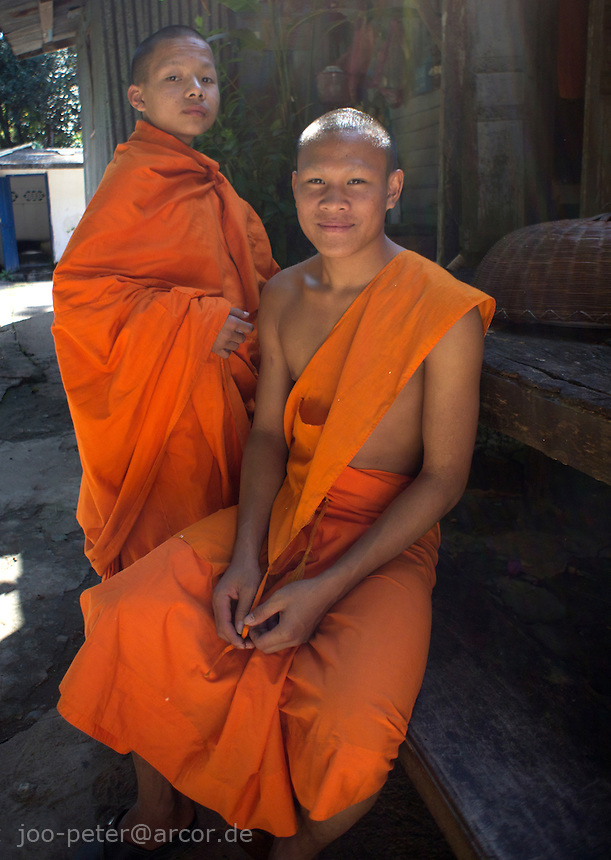 two young buddhist monks,  monastery in Luang Prabang, Laos, 2012