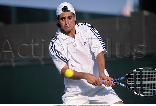 NICOLAS LAPENTTI (ECU), Men's Singles Round 1, Wimbledon 2002 020624 Photo:Steve Bardens/Action Plus...Tennis.The Championships.man Portrait