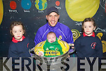 BABBY: Scarlett and Isabella Bright of Lixnaw girls school holds up baby Cliodhna McElligott in the Sam Maguire Cup as Tadgh Kennelly helps out...