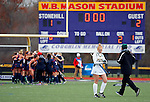 EASTON, MA - NOVEMBER 20:  Shippensburg University players celebrate after the game as Biley Martin (23) of LIU Post walks away during the NCAA Division II Field Hockey Championship at WB Mason Stadium on November 20, 2016 in Easton, Massachusetts.  Shippensburg University defeated LIU Post 2-1 for the national title. (Photo by Winslow Townson/NCAA Photos via Getty Images)