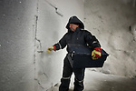 Professor Roland von Bothmer of the Swedish University of Agriculture within the Global Seed Vault carrying a container for seeds for storage. Svalbard, Norway.