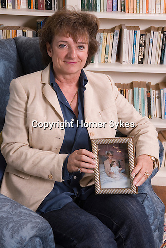 Rosa Monckton friend of the late Diana the Princess of Wales at home. Dallington,  East Sussex. England 2007 + portrait of Diana princess of Wales with Rosa's daughter.