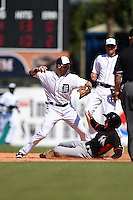Detroit Tigers infielder Andrew Romine (27) throws to first as Alfredo Lopez slides in during a Spring Training game against the Miami Marlins on March 25, 2015 at Joker Marchant Stadium in Lakeland, Florida.  Detroit defeated Miami 8-4.  (Mike Janes/Four Seam Images)