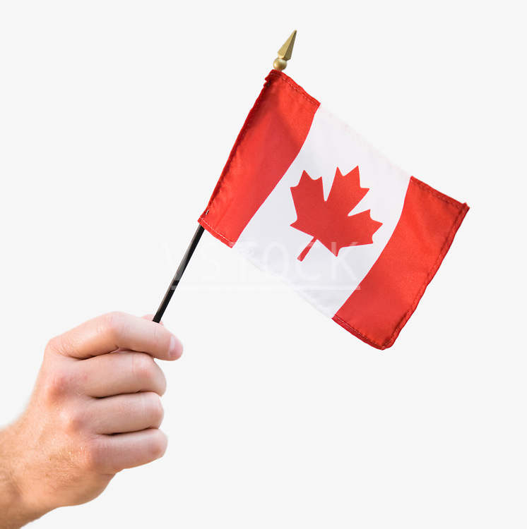 Person holding Canadian flag, close-up