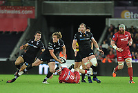 Ospreys' Jeff Hassler evades the tackle of Scarlets' Gareth Davies<br /> <br /> Photographer Ashley Crowden/CameraSport<br /> <br /> Guinness Pro14 Round 6 - Ospreys v Scarlets - Saturday 7th October 2017 - Liberty Stadium - Swansea<br /> <br /> World Copyright &copy; 2017 CameraSport. All rights reserved. 43 Linden Ave. Countesthorpe. Leicester. England. LE8 5PG - Tel: +44 (0) 116 277 4147 - admin@camerasport.com - www.camerasport.com