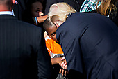 United States President Donald J. Trump shakes hands with an attendee after speaking during a ceremony to commemorate the September 11, 2001 terrorist attacks, at the Pentagon in Washington, D.C., U.S., on Monday, Sept. 11, 2017. Trump is presiding over his first 9/11 commemoration on the 16th anniversary of the terrorist attacks that killed nearly 3,000 people when hijackers flew commercial airplanes into New York's World Trade Center, the Pentagon and a field near Shanksville, Pennsylvania. <br /> Credit: Andrew Harrer / Pool via CNP