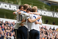 Son Heung-Min of Tottenham Hotspur (centre) is mobbed after scoring his side's second goal with Harry Kane during the Premier League match between Tottenham Hotspur and Bournemouth at White Hart Lane, London, England on 15 April 2017. Photo by Mark  Hawkins / PRiME Media Images.