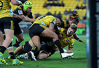 Julian Savea and Jordie Barrett tackle Anton Lienert-Brown during the Super Rugby quarterfinal match between the Hurricanes and Chiefs at Westpac Stadium in Wellington, New Zealand on Friday, 20 July 2018. Photo: Dave Lintott / lintottphoto.co.nz