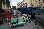 A young boy plays among boxes of beverages in front of a shop in the old town of Qingdao.Tsingtao beer, established by a German beer company in 1903, is sold everywhere.