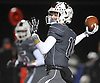 Michael Proios #10, Mepham quarterback, throws a pass for a first down during the Nassau County Conference II varsity football semifinals against Carey at Hofstra University on Friday, Nov. 10, 2017.