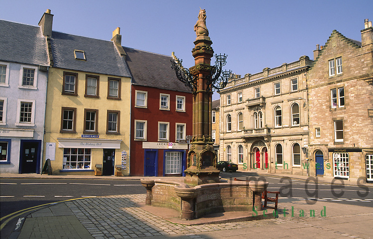 Old houses in Jedburgh town centre and shops on Market Place Scottish Borders Scotland UK