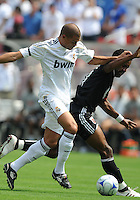Real Madrid defender Pepe (3) versus DC United forward Luciano Emilio (10).Real Madrid defeated DC United 3-0 at FedEx Field, Sunday August 9, 2009 in an International Friendly.