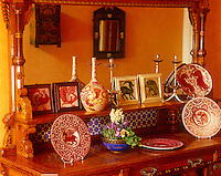 A collection of lustreware by William de Morgan is displayed on an Arts & Crafts sidetable
