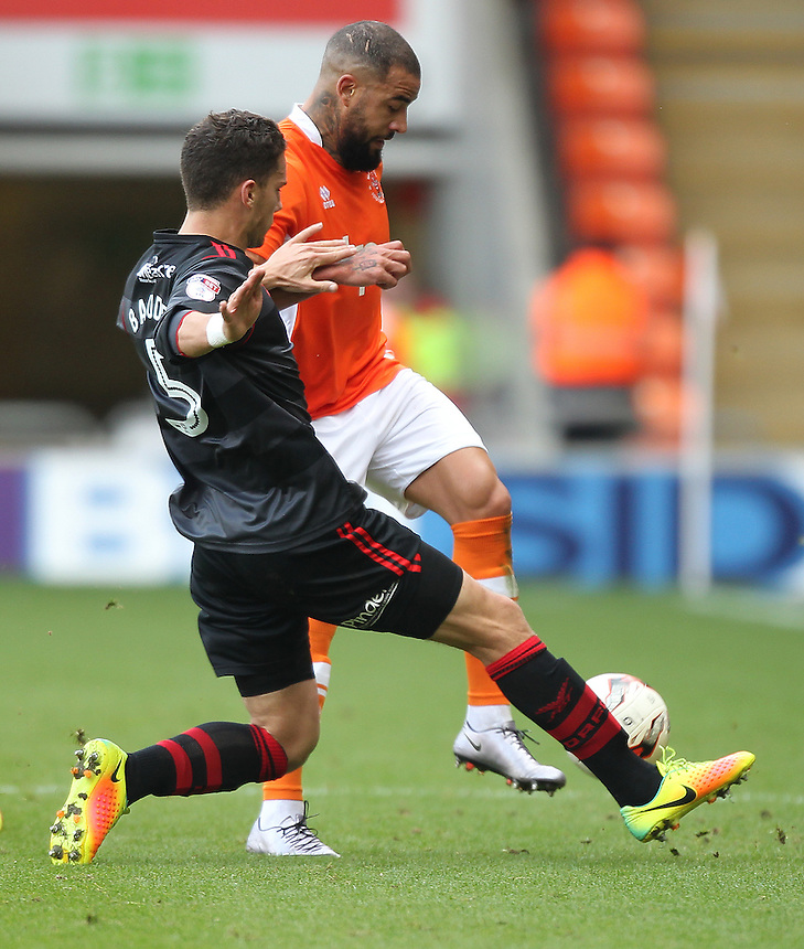 Blackpool's Kyle Vassell battles with  Doncaster Rovers' Mathieu Baudry<br /> <br /> Photographer Mick Walker/CameraSport<br /> <br /> The EFL Sky Bet League Two - Blackpool v Doncaster Rovers - Saturday 22nd October 2016 - Bloomfield Road - Blackpool<br /> <br /> World Copyright &copy; 2016 CameraSport. All rights reserved. 43 Linden Ave. Countesthorpe. Leicester. England. LE8 5PG - Tel: +44 (0) 116 277 4147 - admin@camerasport.com - www.camerasport.com