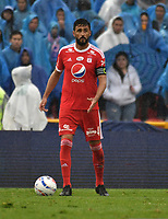 BOGOTA - COLOMBIA - 04 – 03 - 2018: Diego Herner, jugador de America de Cali, en acción, durante partido de la fecha 6 entre Millonarios y America de Cali, por la Liga Aguila I 2018, jugado en el estadio Nemesio Camacho El Campin de la ciudad de Bogota. / Diego Herner, player of America de Cali, in action during a match of the 6th date between Millonarios and America de Cali, for the Liga Aguila I 2018 played at the Nemesio Camacho El Campin Stadium in Bogota city, Photo: VizzorImage / Luis Ramirez / Staff.