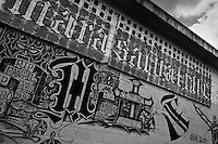 A Mara Salvatrucha gang graffiti painted on the wall of the prison in Tonacatepeque, El Salvador, 18 May 2011. During the last two decades, Central America has become the deadliest region in the world that is not at war. According to the UN statistics, more people per capita were killed in El Salvador than in Iraq, in recent years. Due to the criminal activities of Mara Salvatrucha (MS-13) and 18th Street Gang (M-18), the two major street gangs in El Salvador, the country has fallen into the spiral of fear, violence and death. Thousands of Mara gang members, both on the streets or in the overcrowded prisons, organize and run extortions, distribution of drugs and kidnappings. Tattooed armed young men, mainly from the poorest neighborhoods, fight unmerciful turf battles with their coevals from the rival gang, balancing between life and death every day. Twenty years after the devastating civil war, a social war has paralyzed the nation of El Salvador.