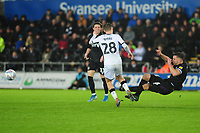 George Byers of Swansea City is fouled by Jason Pearce of Charlton Athletic during the Sky Bet Championship match between Swansea City and Charlton Athletic at the Liberty Stadium in Swansea, Wales, UK.  Thursday 02 January 2020