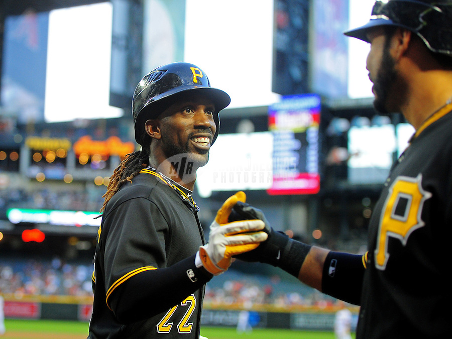 Apr. 17, 2012; Phoenix, AZ, USA; Pittsburgh Pirates outfielder Andrew McCutchen is congratulated by a teammate after scoring in the first inning against the Arizona Diamondbacks at Chase Field. Mandatory Credit: Mark J. Rebilas-