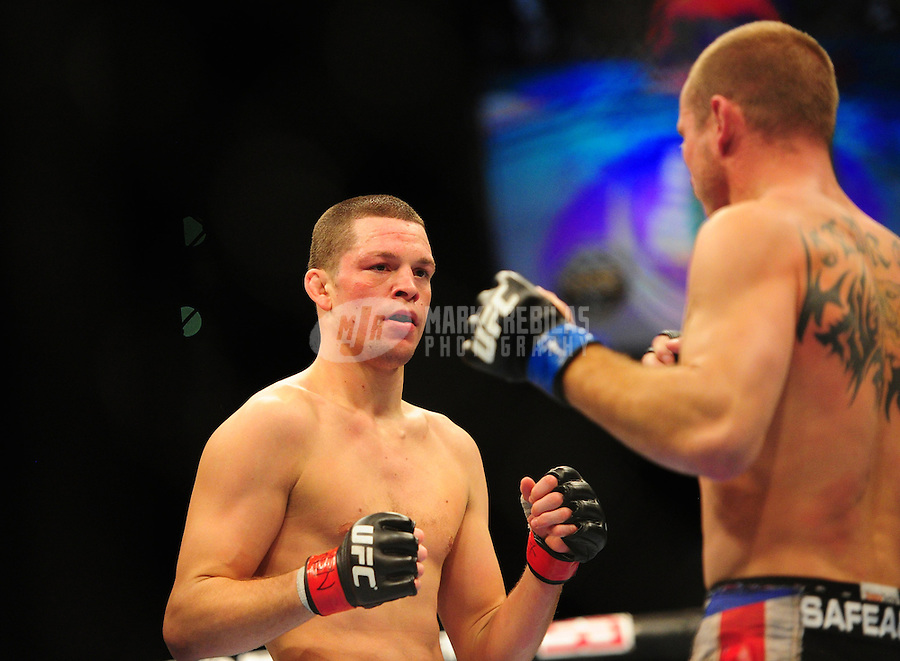 Dec 30, 2011; Las Vegas, NV, USA; UFC fighter Nate Diaz (left) against Donald Cerrone during a lightweight bout at UFC 141 at the MGM Grand Garden event center. Mandatory Credit: Mark J. Rebilas-