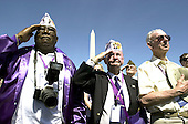 Washington, D.C. - May 29, 2004 -- Veterans, from left to right: Ransom Jordan, Thomas 'Top' Vernor, and Calvin Young salute during the trooping of the colors at the dedication ceremony of the National World War 2 Memorial in Washington, D.C. on May 29, 2004..Credit: Ron Sachs / CNP