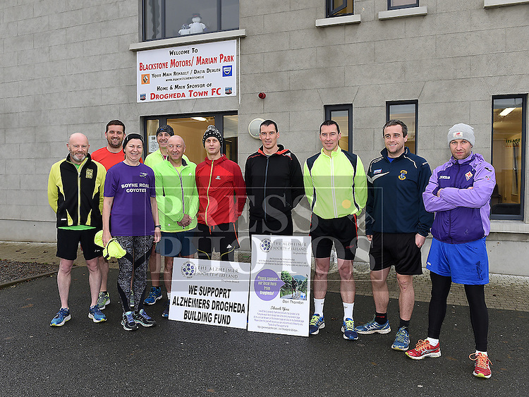 Don Thornton pictured with local runners on Day 183 of 365, the halfway point along his journey of running 10k a day for 365 days. Photo:Colin Bell/pressphotos.ie