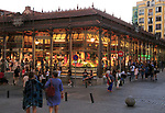 Mercado de San Miguel market historic building exterior lights in evening, Madrid city centre, Spain built 1916