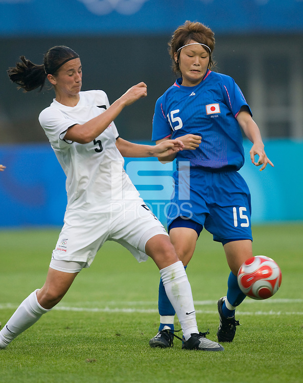 Japanese midfielder (15) Mizuho Sakaguchi has the ball cleared away from her by New Zealand defender (5) Abby Erceg during first round play in the 2008 Beijing Olympics at Qinhuangdao, China. Japan tied New Zealand, 2-2, at Qinhuangdao Stadium.