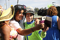 HALLANDALE BEACH, FL - JANUARY 28: Jockey Antonio Gallardo joins fans for a selfie after winning the $400K Poseidon on Imperative at Gulfstream Park. (Photo by Arron Haggart/Eclipse Sportswire/Getty Images