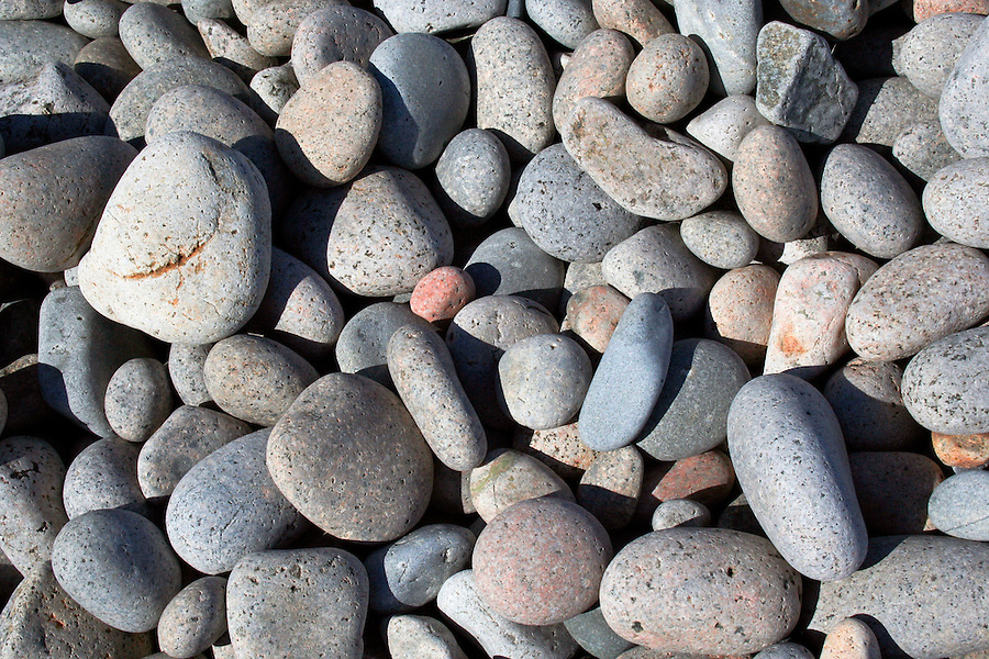 Seaside background of smooth rocks