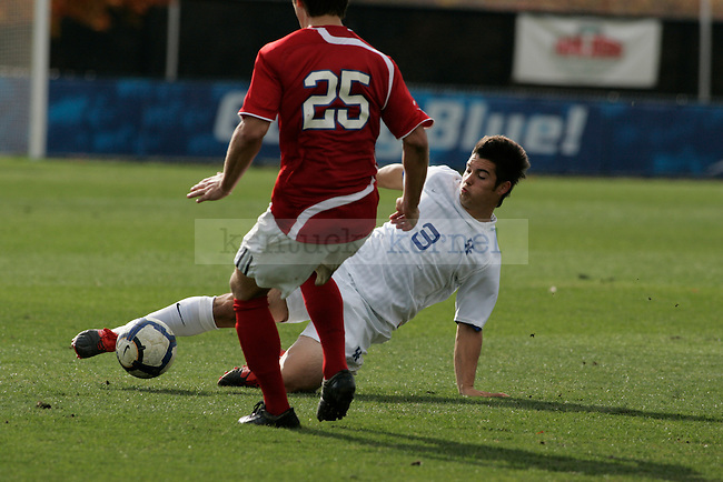Sophomore Chris Jumalon slide tackles an SMU player during UK's game against SMU at Softball and Soccer Complex on Wednesday, Nov. 4, 2009. Photo by Allie Garza | Staff