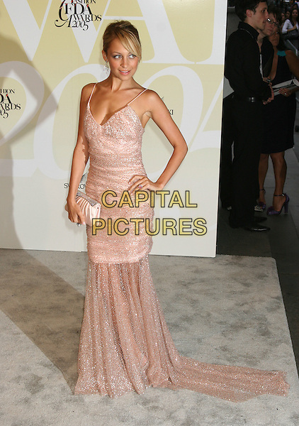 NICOLE RICHIE.2005 CFDA Fashion Awards - Inside Arrivals.New York Public Library in New York City, New York, USA, June 6th 2005 .full length pink sequined beaded dress hand on hip clutch bag .Ref: IW.www.capitalpictures.com.sales@capitalpictures.com.©Ian Wilson/Capital Pictures.