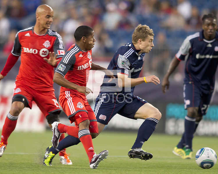 New England Revolution forward Zak Boggs (33) on the attack as Toronto FC forward Joao Plata (7) defends. In a Major League Soccer (MLS) match, the New England Revolution tied Toronto FC, 0-0, at Gillette Stadium on June 15, 2011.