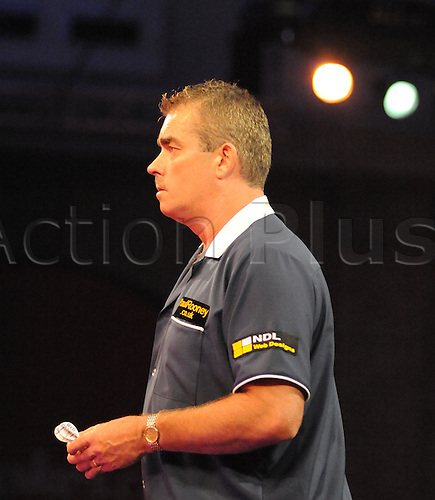 16.12.2010 Ladbrokes.Com World Darts Championships. Alexandra Palace London. First round loser Steve Beaton watches Mark Hylton hit the winning double