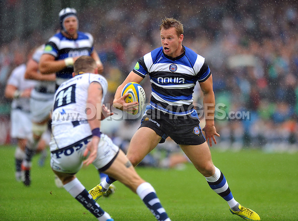 Chris Cook in possession. Pre-season friendly match, between Bath Rugby and Bristol Rugby on August 17, 2013 at the Recreation Ground in Bath, England. Photo by: Patrick Khachfe / Onside Images