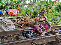 People in the old and disused railway yards in Battambang, Cambodia