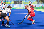 Jill Witmer #10 of United States dribbles the ball while Julia Muller #28 of Germany covers during USA vs Germany in a women's quarterfinal game at the Rio 2016 Olympics at the Olympic Hockey Centre in Rio de Janeiro, Brazil.