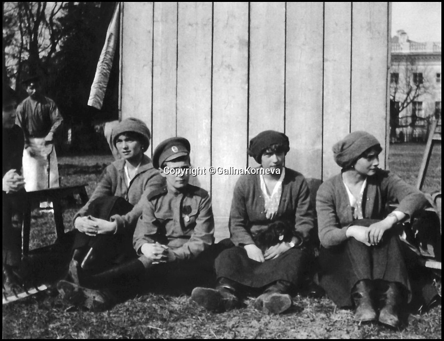 BNPS.co.uk (01202 558833)Pic: GalinaKorneva/BNPS<br /> <br /> The Tsar's children at Tsarskoe Selo, 1917.<br /> Olga, Alexei, Anastasia and Tatiana taking a rest after working in the kitchen<br /> garden in the Alexander Park, May 1917.<br /> <br /> A Russian Grand Duke branded King George V a 'scoundrel' who 'did not lift a finger' to save the Romanov family in the revolution there of 1917, explosive diaries have revealed.<br /> <br /> The cousin of the overthrown Russian Royal family blamed the British King for their executions because he failed to grant them refuge.<br />  <br /> Dmitri Pavlovich no-holds-barred diary extracts have been published for the first time in a new book by respected historian Coryne Hall, To Free The Romanovs.