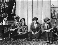 BNPS.co.uk (01202 558833)Pic: GalinaKorneva/BNPS<br /> <br /> The Tsar&rsquo;s children at Tsarskoe Selo, 1917.<br /> Olga, Alexei, Anastasia and Tatiana taking a rest after working in the kitchen<br /> garden in the Alexander Park, May 1917.<br /> <br /> A Russian Grand Duke branded King George V a 'scoundrel' who 'did not lift a finger' to save the Romanov family in the revolution there of 1917, explosive diaries have revealed.<br /> <br /> The cousin of the overthrown Russian Royal family blamed the British King for their executions because he failed to grant them refuge.<br />  <br /> Dmitri Pavlovich no-holds-barred diary extracts have been published for the first time in a new book by respected historian Coryne Hall, To Free The Romanovs.