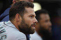 OAKLAND, CA - JUNE 14:  Mac Williamson #12 of the Seattle Mariners watches from the dugout during the game against the Oakland Athletics at the Oakland Coliseum on Friday, June 14, 2019 in Oakland, California. (Photo by Brad Mangin)
