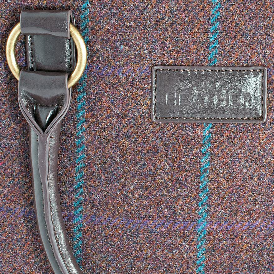 Product detailed shot of ladies tweed handbag