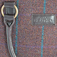 Product detailed shot of ladies tweed handbag