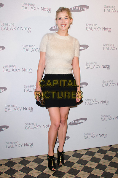 Rosamund Pike.Samsung celebrates the launch of the Galaxy Note 10.1 held at One Mayfair..London, England..August 15th, 2012.full length sweater jumper black skirt clutch bag ankle boots peep toe white knitted .CAP/CJ.©Chris Joseph/Capital Pictures.