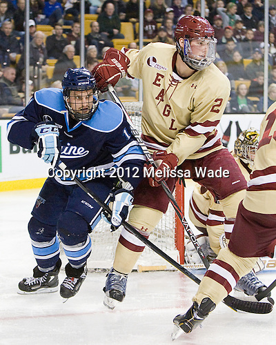 Theo Andersson (Maine - 11), Brian Dumoulin (BC - 2) - The Boston College Eagles defeated the University of Maine Black Bears 4-1 to win the 2012 Hockey East championship on Saturday, March 17, 2012, at TD Garden in Boston, Massachusetts.