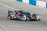Eventual race winner, the No. 2 Audi, sweeps through the first turn during action at the 2012 Sebring race.