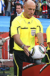 24 JUN 2010:  Referee Howard Webb (ENG) picks up the game ball.  The Slovakia National Team led the Italy National Team 1-0 at half time at Ellis Park Stadium in Johannesburg, South Africa in a 2010 FIFA World Cup Group F match.